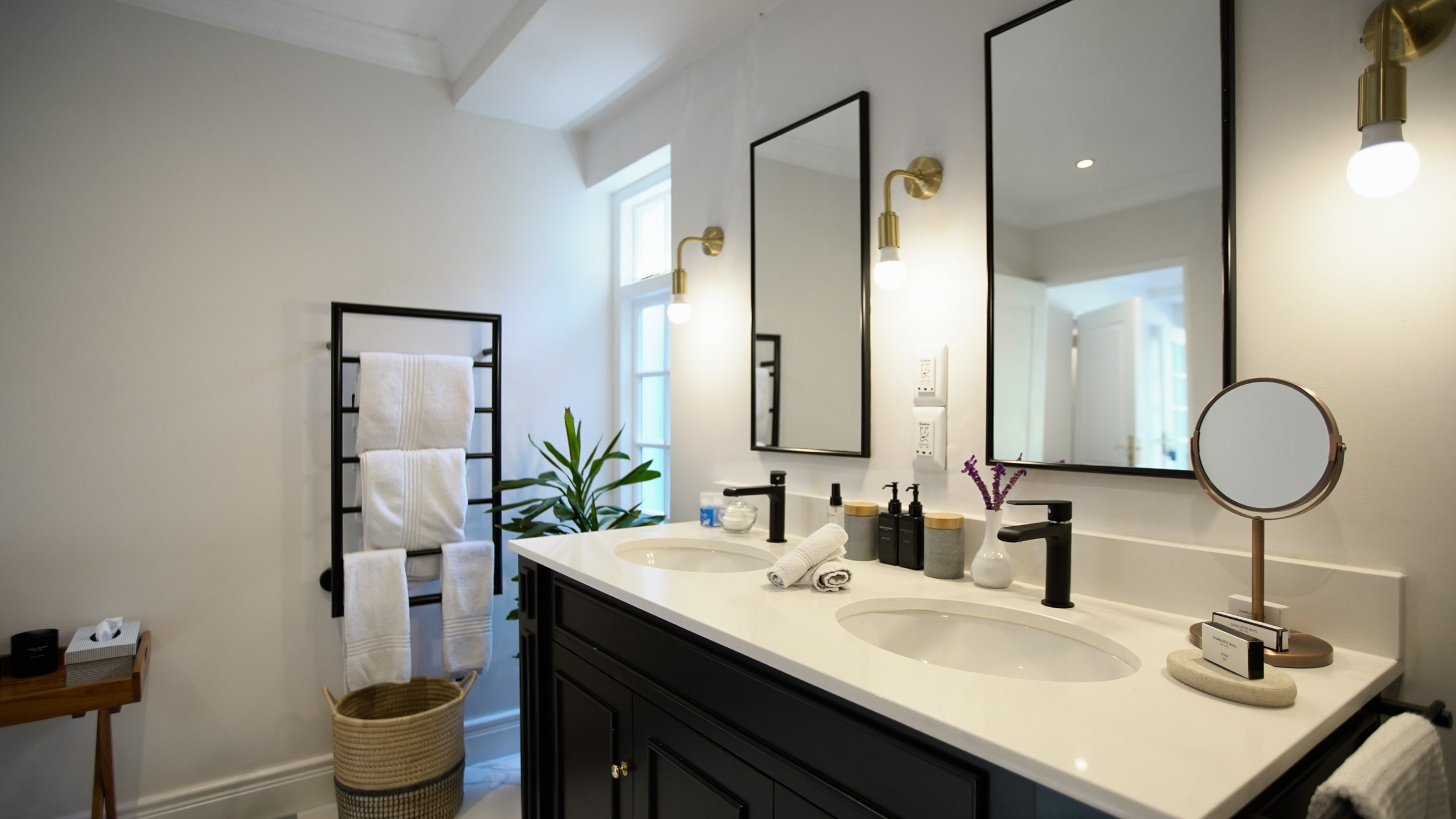 Two sinks and mirrors with fresh white towels in Bathroom in Manor room bedroom suite at Villa Coloniale