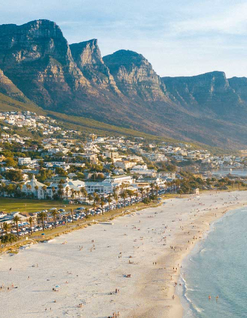 Camps Bay beachfront with mountains in the background