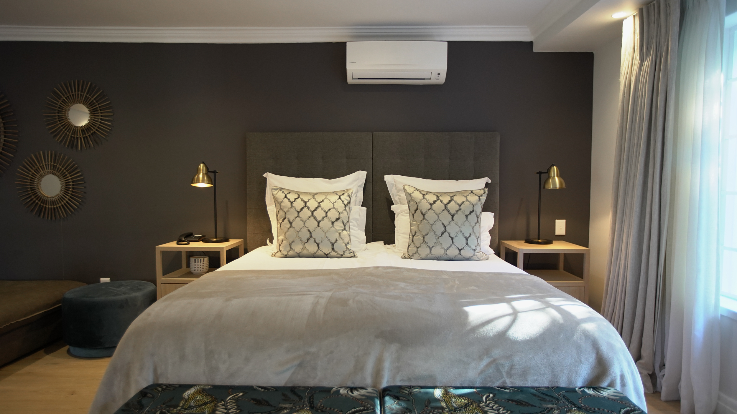 Bed with pillows and side tables with lamps in Manor room bedroom suite at Villa Coloniale